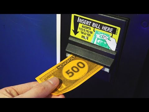 Trying to use Monopoly Money at the Arcade!
