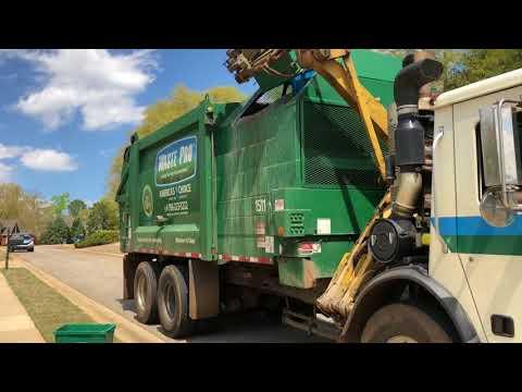 2 waste pro ASL garbage trucks