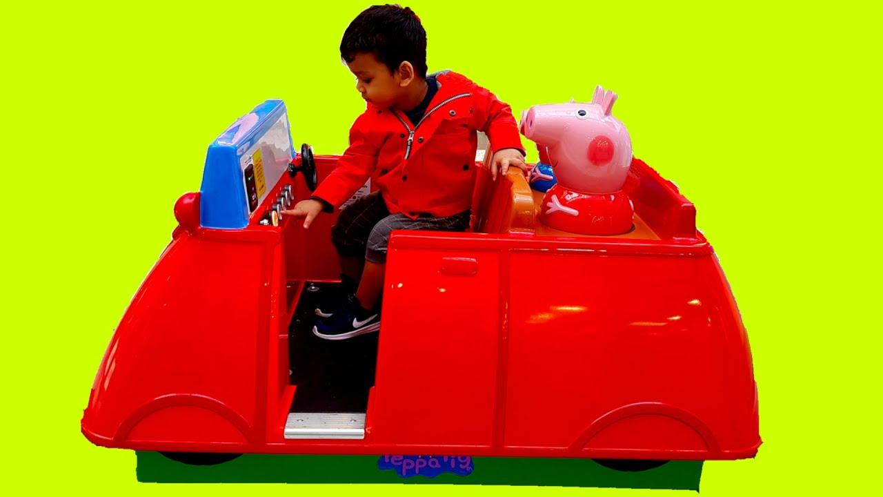 Little Boy Playing on Peppa Pig Ride on Car - Wheel on the Bus Nursery Rhyme,
