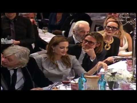 Brad Pitt & Angelina Jolie Bid and Kiss at Cinema For Peace Gala