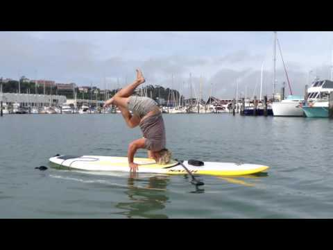 The Wellness Shed headstand on Naish Paddle Board by Mike