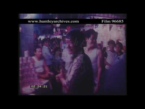 Street Market in Singapore in 1982.  Archive film 96685