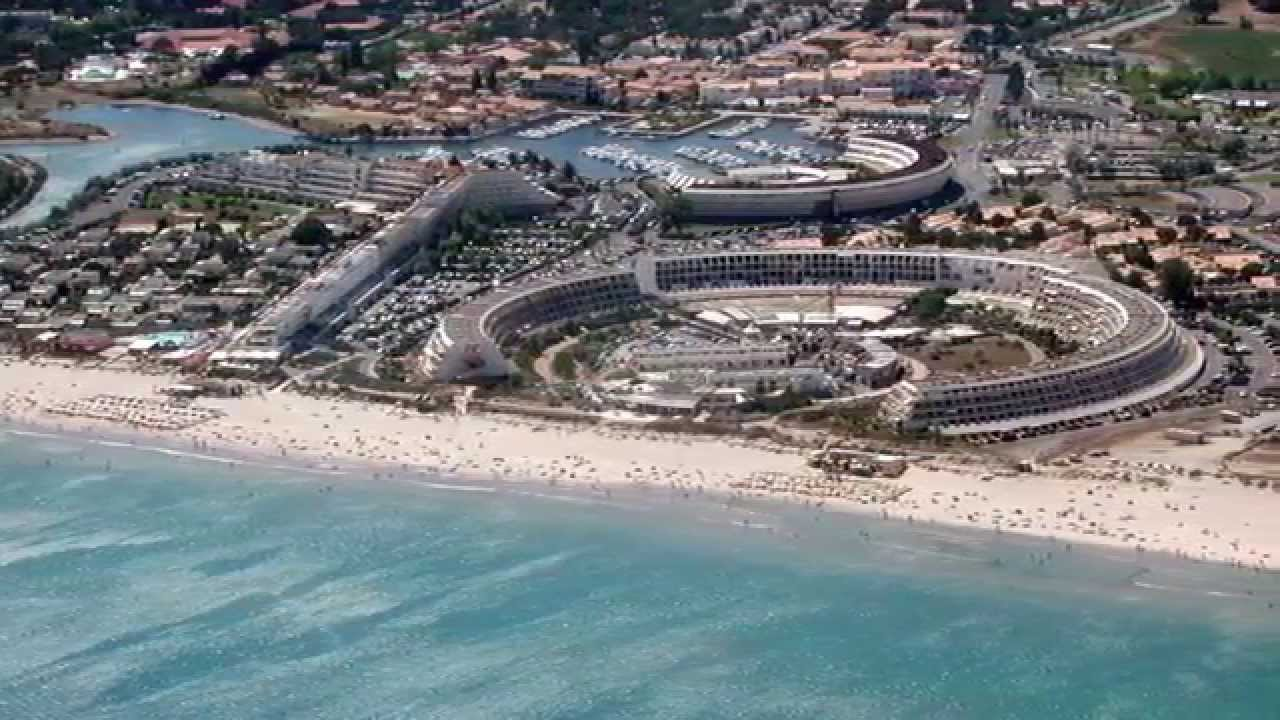French naturist beach Cap d'Agde steamy platinum-blonde dogging.