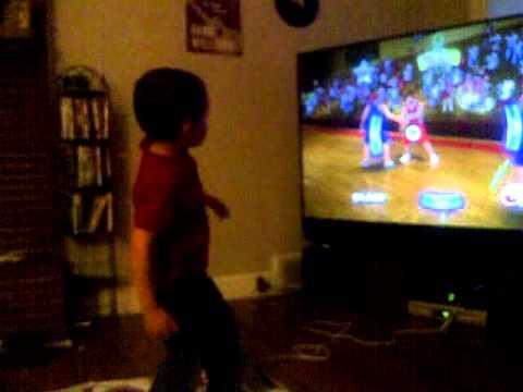 Nephew on dance pad w/ HSM3
