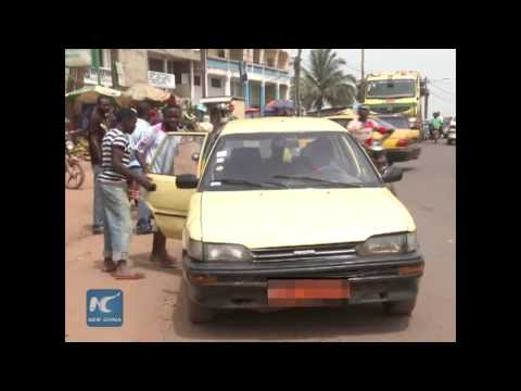 Happiness and bitterness of a taxi driver in Cameroon