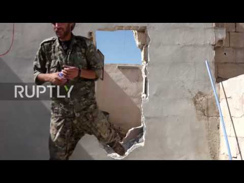 Syria: Look down Kurdish sniper's scope as he scans for IS on Raqqa's outskirts *GRAPHIC*
