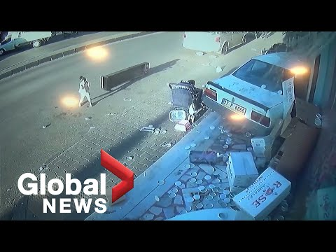 CCTV footage shows moment driver crashes into Turkish shop, narrowly missing children