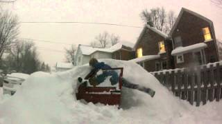 Buried Jeep makes it out of snow.