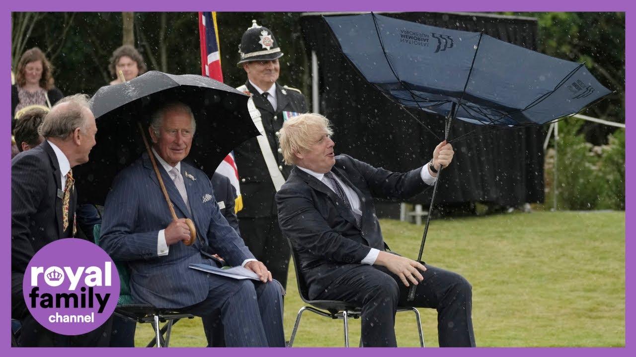Prince Charles Giggles as Boris Johnson Battles Umbrella