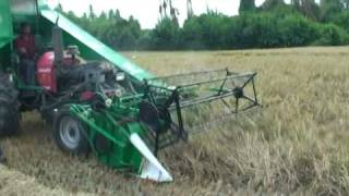 tractor mounted rice combine harvester working in india