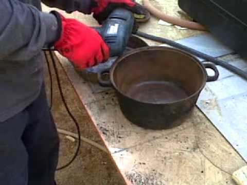 remove rust from cast iron pots using a drill with wire brush - YouTube