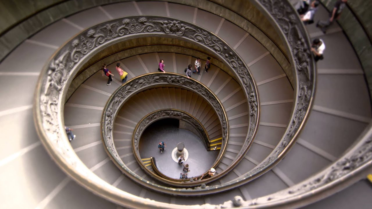 Slow motion descent down large spiral staircase - YouTube