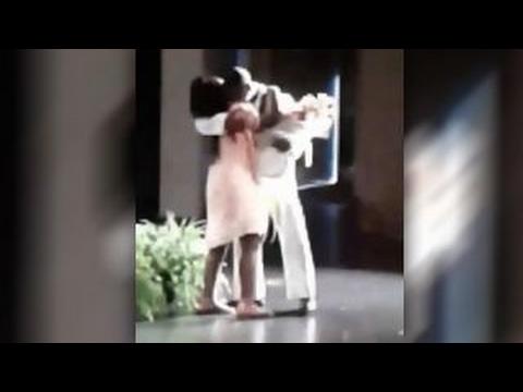 Watch Navy Dad Surprise Daughter at School Graduation!