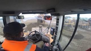 Volvo L120F loading trucks cab veiw