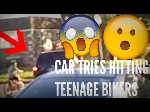 CAR TRIES HITTING TEENAGE BIKERS