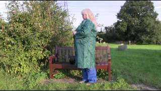 Repeat youtube video Colleen in a country churchyard wearing her Green nylon mac, blue rain trousers and rubber boots