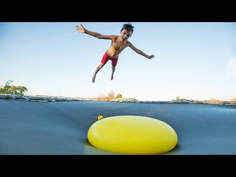 Download Youtube: JUMPING ONTO A GAINT 6FT WATER BALLOON!!