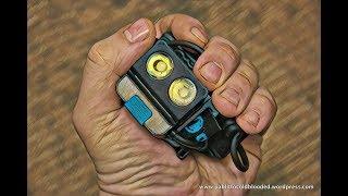 Відео огляд компактного перезаряжаемого налобного ліхтаря Olight H16 Wave.