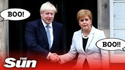 Angry Scots boo Boris as he meets Nicola Sturgeon in Edinburgh
