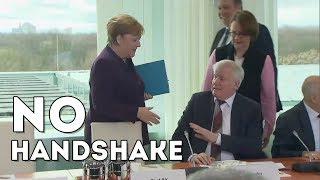 German interior minister horst seehofer declined a friendly handshake with chancellor angela merkel as germany scrambles to contain the spread of novel c...