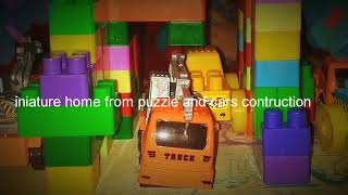 Playing Miniature home from puzzle and cars