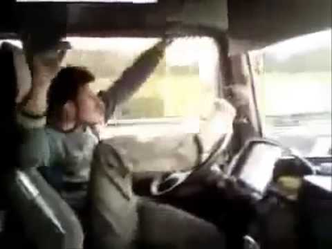The Craziest Truck Driver Ever dances while driving on highway