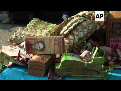 Venezuelans recycle worthless bolivar bills into crafts