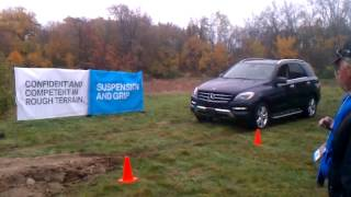 BMW X5 xdrive demonstration and suspension travel includes Porsche, Mercedes, and Infiniti
