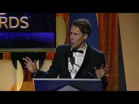 Dustin Lance Black accepts the Writers Guild of America West's 2018 Valentine Davies Award