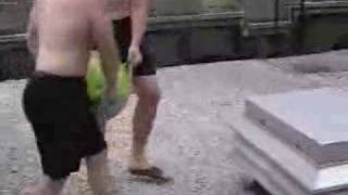 Throwing A Giant Water Balloon Off A Roof Onto A Port-a-pott