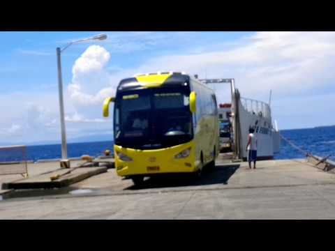 A boat carrying four big vehicles and passangers! It's amazing Philippines life...