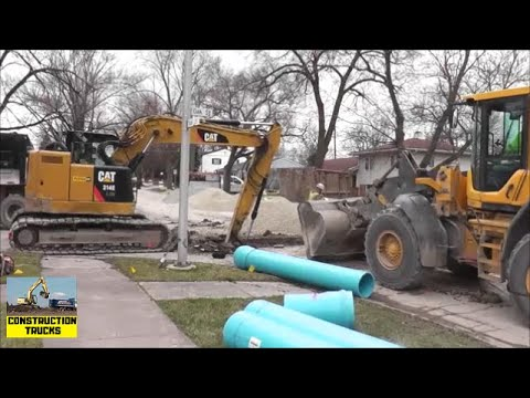 Stormwater Pipe Laying Crew With Excavator, Wheel Loader, an