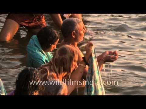 Hindu devotees taking a holy dip during Maha Shivratri at Varanasi Ghat