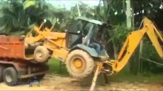Excavator loads itself into the truck Scania