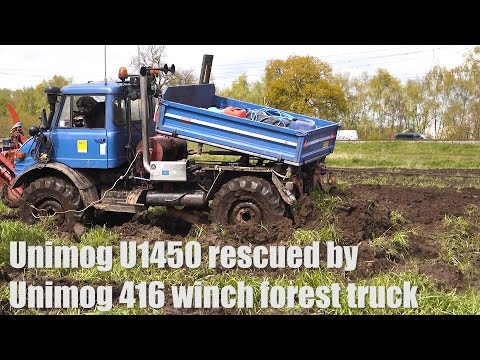 Unimog 416 recovers Unimog U1450 out of the mud