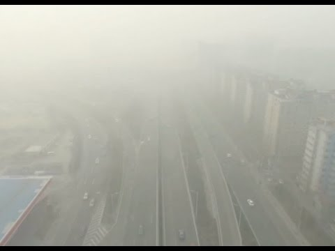 Thick Haze Enveloping North China, Affecting Daily Life