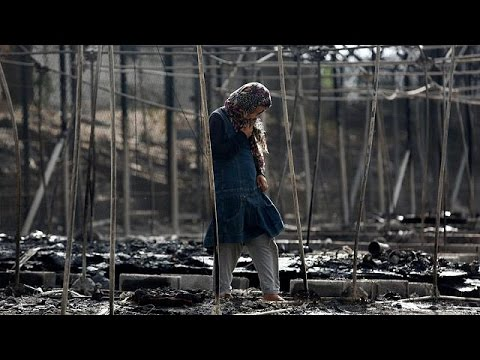 Thousands flee and fire destroys Lesbos migrant camp