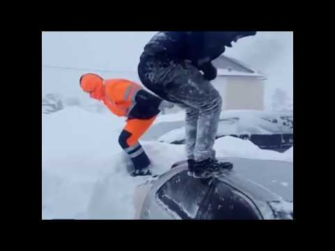 Shirtless men go snow-diving after blizzard in Sakhalin, Russia
