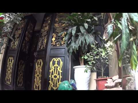 Walk through to hidden coffee shop Hanoi