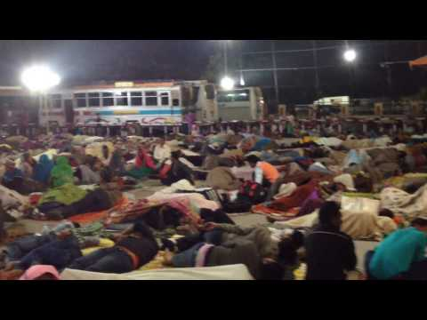 People sleeping on the ground in Varanasi's train station