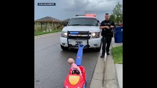 Adorable video shows police officer dad 'pulling over' 10-month-old daughter