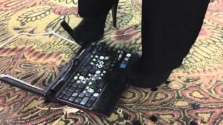 Girl Hard Crush Netbook With Muddy High Heels Boots