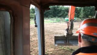 Fiat-Hitachi EX135 excavator sperading soil