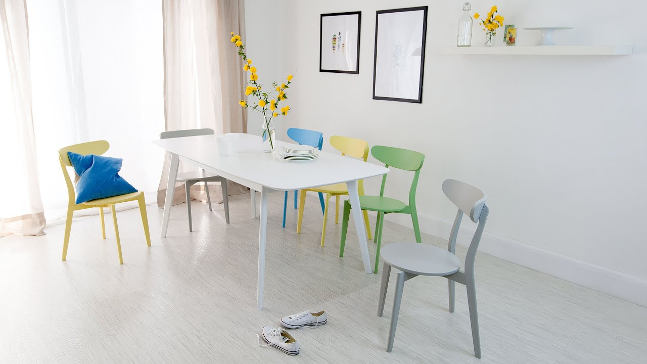 white extending dining table and colourful dining chairs - youtube