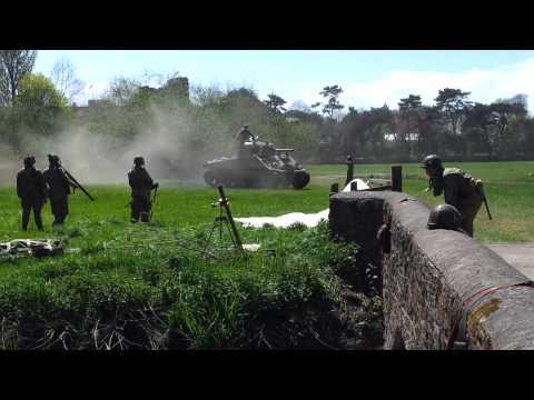 M4A4 Sherman tank at speed accross field.