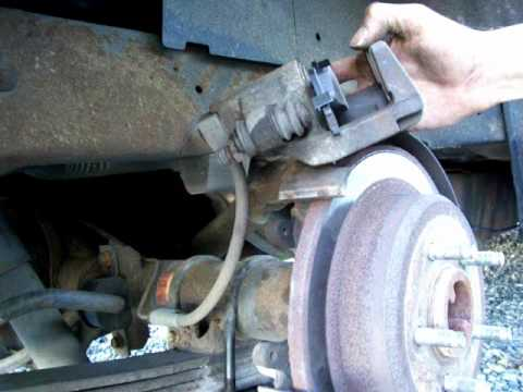 How to replace Ford Explorer Brake Pads  YouTube