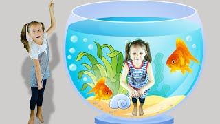Elina and Julia funny girls play at the children aquarium