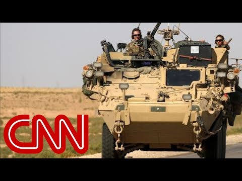 Troops begin removing military equipment from Syria