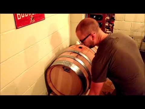 Topping up an Wine Barrel to Prevent Oxidation