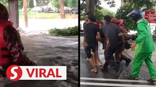 Fireman almost drowns during flood rescue operation in Melaka